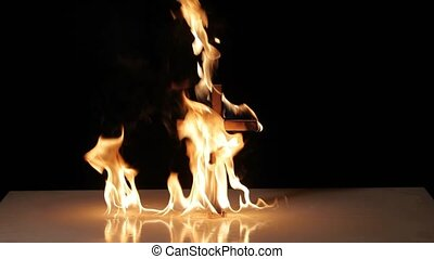 Fire around a burning cross symbol