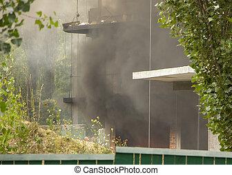 Fire At a construction site, unfinished multi-storey reinforced concrete building