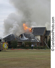 Fire at nice house - Firemen responding to house fire