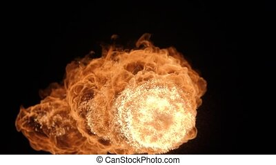 Fire ball explosion, high speed camera, isolated fire flame on black background.