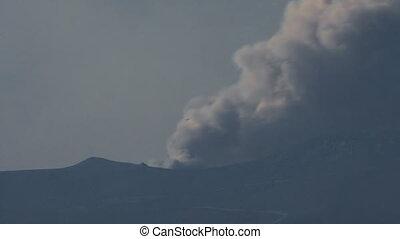 Fire behind mountain range, long shot timelapse