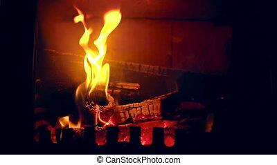 Fire Blaze - Shot of logs burning in fireplace flame in...