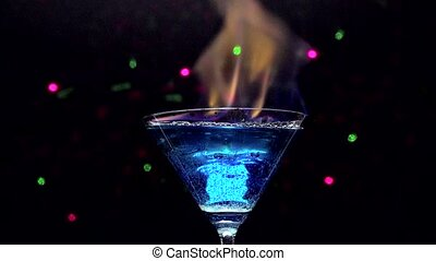 Fire blowing out of blue lagoon - closeup with black...