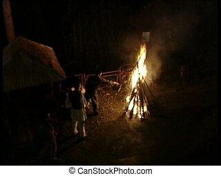 FIRE bonfire and men stoking it up - Bonfire with men...