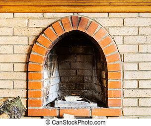 fire-box of not kindled brick fireplace