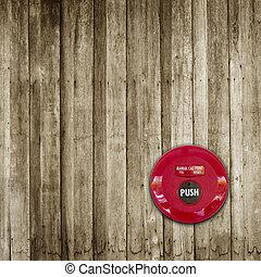 Fire break glass alarm switch on wooden wall background