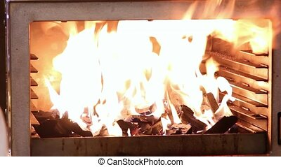 Fire brightly burning in the furnace, Chef light up fire more.