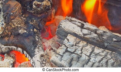 Fire burning in slow motion with wood falling