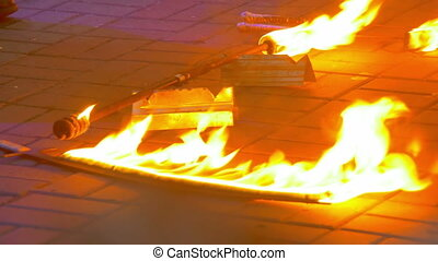 Fire Burning on the Fire Show. Fire Show Performance at...
