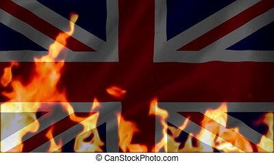 Fire burning the union-jack flag of united kingdom