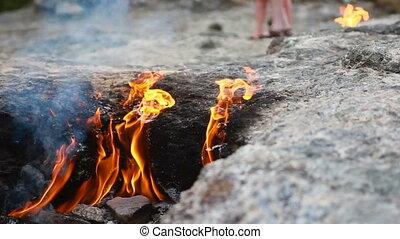 fire burns from under the stones - Fire Mountain Yanartash,...