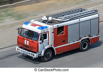 Fire car moving on the road (all logos, inscriptions and...