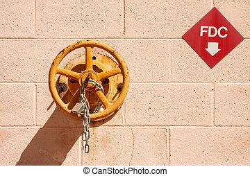 Fire Company Valve on Block Wall