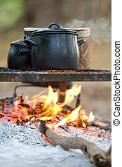 Fire cooking - Three cooking pots on an open fire...