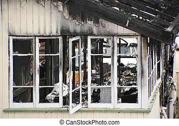 Abandoned and fire damaged house