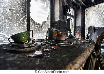 Fire damaged interior details in summer house after blaze