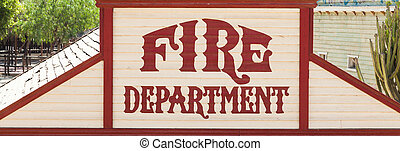 Fire department - Old fire department sign painted on wood.