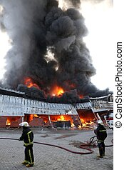 Fire Disaster in Warehouse - Warehouse building burning with...
