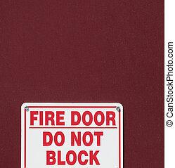 Fire door sign. - Fire door sign displayed on a door...