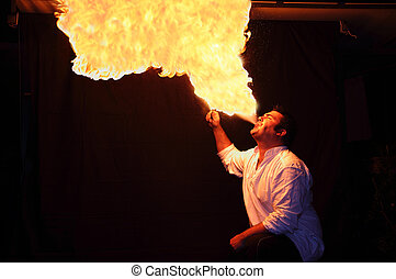 fire-eater flame - fire-eater with flame over dark ...