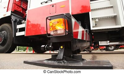 fire-engine and it foot of support with light alarm system close up