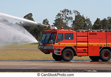 Fire Engine - Red fire truck with water being sprayed