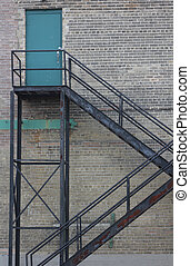 Fire Escape - A blue door and fire escape against a brick...