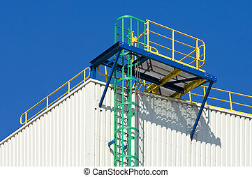 Brightly colored fire escape on an industrial building