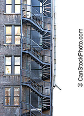 Fire escape - fire escape on run down building with brick...