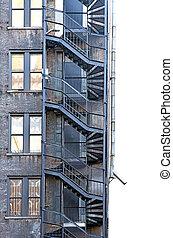 Fire escape - fire escape on run down building with brick ...