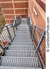 Fire escape ladder - metal stairs on the side of a building