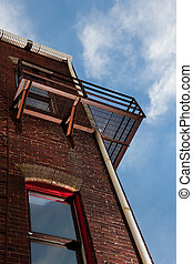 Fire escape on brick building from below