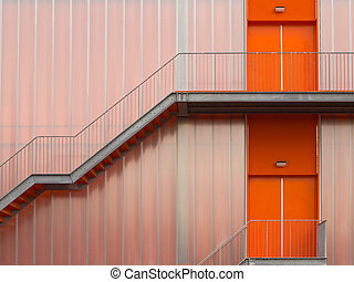 Fire escape stairs on the outside of a modern sports hall