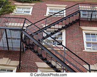 Fire exit on the side of old red brick apartment