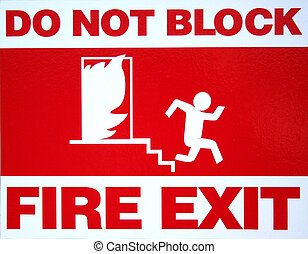 Fire Exit - Red and white fire exit sign in commercial...