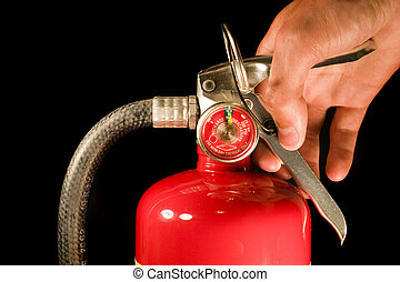 Fire Extinguisher - A red fire extinguisher on a black ...