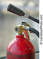 carbon dioxide fire extinguisher, and a funnel with a tube for gas