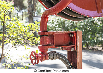 Fire extinguisher in a garden.