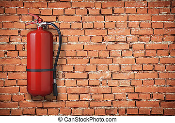fire extinguisher on red brick wall