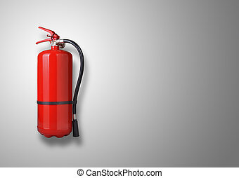 Fire extinguisher on the gray wall