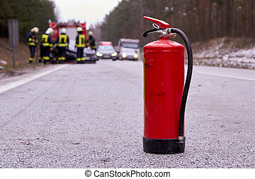 fire extinguisher on the road next to car accident