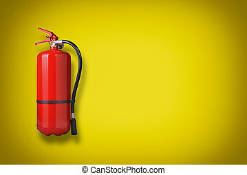 Fire extinguisher on the yellow wall