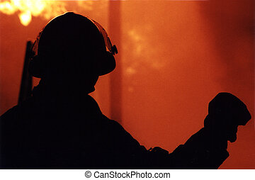 Fire Fighter Night - Silhouette of Fire Fighter in front of...
