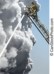 Fire Fighters - A Fire Man on a lift up high hosing a fire ...