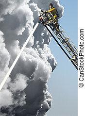 Fire Fighters - A Fire Man on a lift up high hosing a fire...