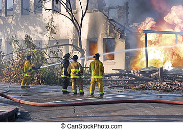 Fire Fighters - Four fire men taking control of a building ...