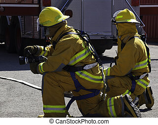 Fire fighters in training - Student firefighters practice...