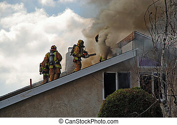 Fire Fighters onRoof - Fire fighters on the roof of a house...