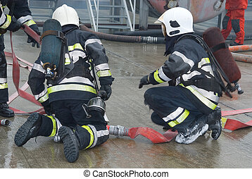 Fire fighters preparing hoses - Firefighters connecting...