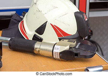 Fire fighting equipment - hydraulic shears and helmet from...